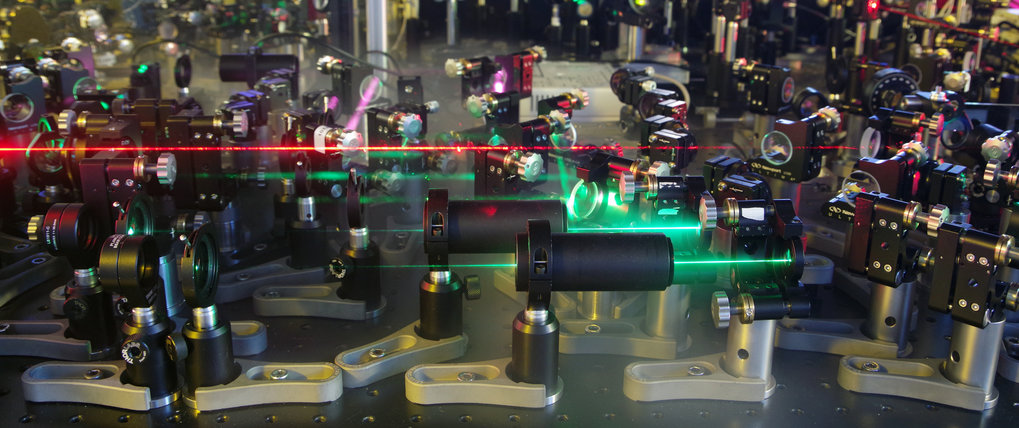 Mirrors, lights, action: Researchers use laser pulses to probe the dynamic behavior of atoms and elections.